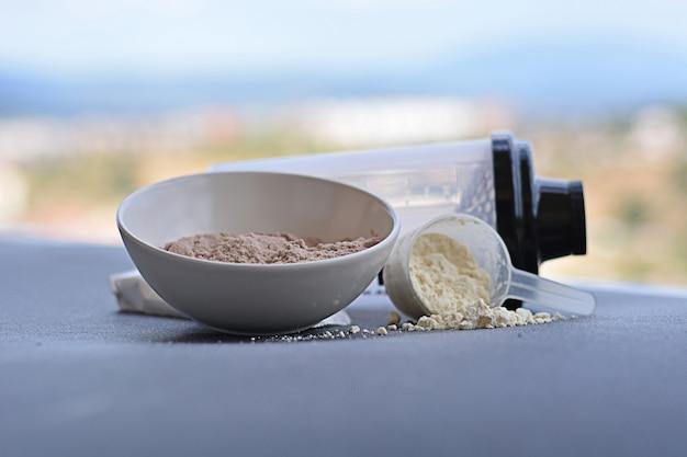 Gusto proteico di siero di latte alla vaniglia e cioccolato