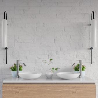 Lavandino bianco del bagno che sta sullo scaffale del gabinetto.
