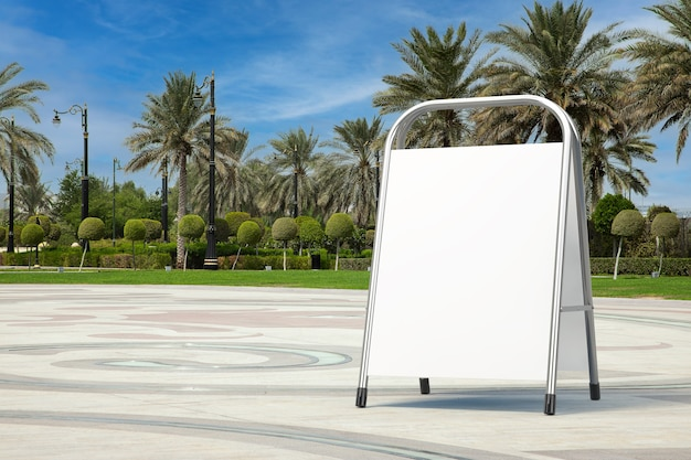 Stand promozionale pubblicitario vuoto bianco come modello per il tuo design in una strada di città vuota con primo piano estremo di palme. rendering 3d