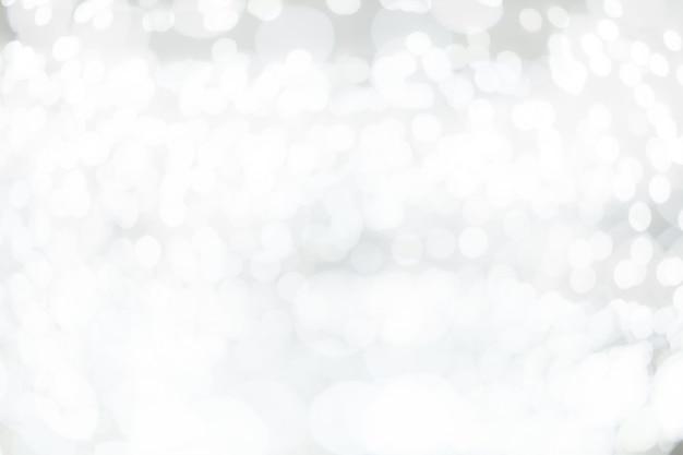 Fondo bianco dell'estratto del bokeh della sfuocatura.