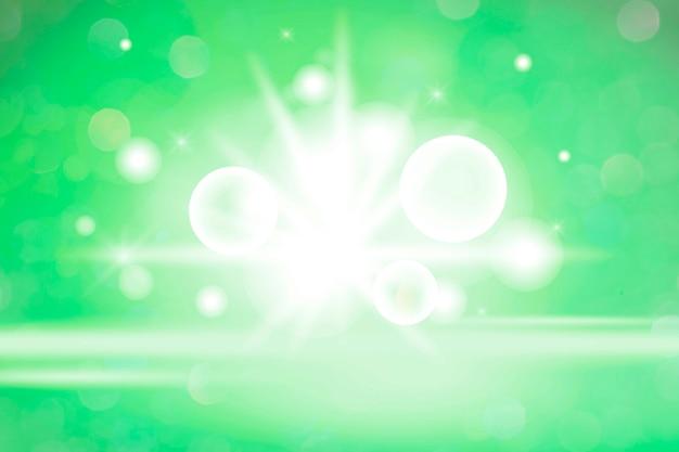 Luce bokeh bianca su sfondo verde