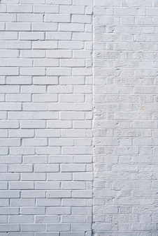 Fondo bianco di struttura del muro di mattoni