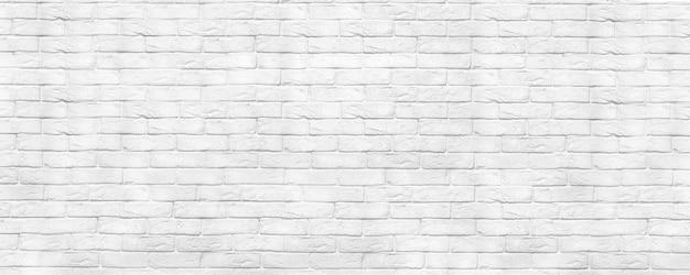 Contesto panoramico di struttura del muro di mattoni bianchi. sfondo di design lavato per la casa e l'ufficio. muro di mattoni dipinti