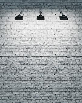 Muro di mattoni bianchi con tre faretti illuminanti