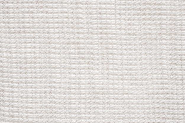 Fondo bianco del modello di struttura del panno del tessuto di cotone