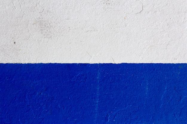 Struttura della vernice bianca e blu scuro. sfondo con spazio per il testo.
