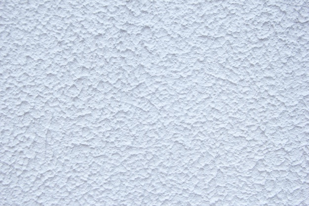 Intonaco decorativo bianco. texture di una parete intonacata. fondo bianco di struttura.