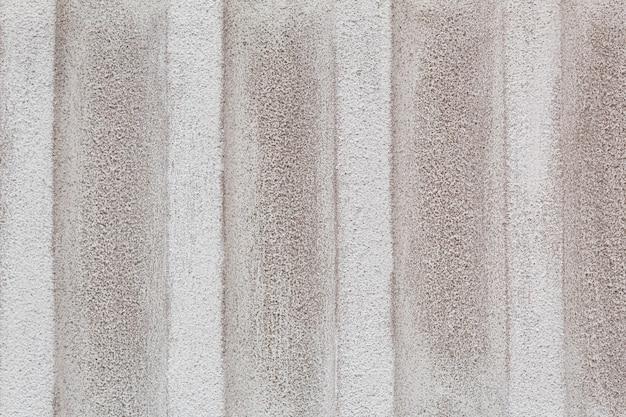Muro di cemento strutturato sporco bianco in primo piano, priorità bassa strutturata