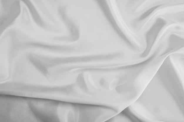 Fondo astratto di struttura del tessuto bianco