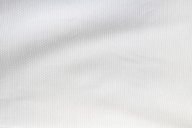 Maglia da calcio bianca abbigliamento tessuto trama abbigliamento sportivo sfondo, primi piani