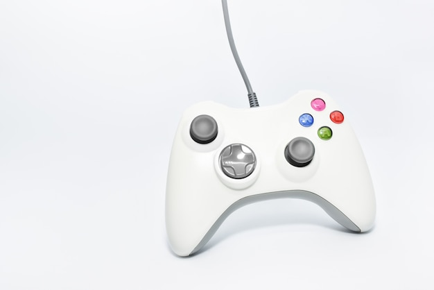 White gaming console game pad isolato