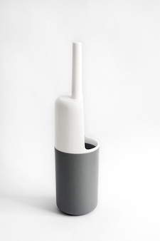 Scopino per wc in plastica bianco e grigio su bianco
