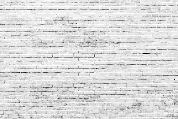 Fondo bianco e grigio di struttura del muro di mattoni
