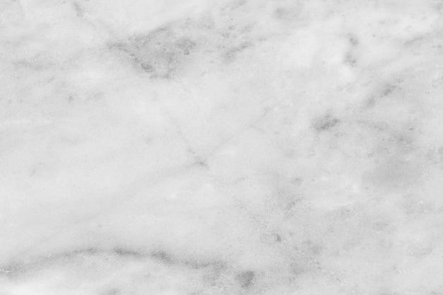 La struttura di marmo bianca sporca ha polvere di fondo e modello di pietra.