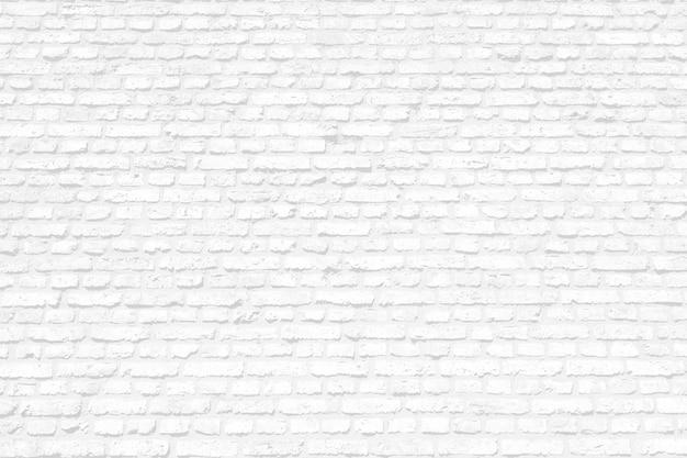 Fondo dipinto di bianco del muro di mattoni