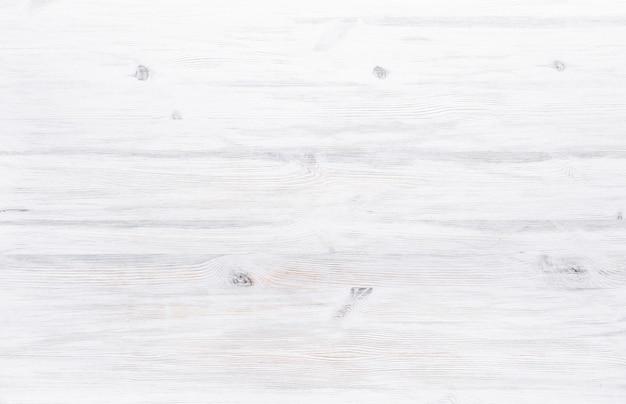 Tavolo scrivania in legno verniciato bianco, tavolo rustico in legno chiaro chiaro bianco chiaro struttura in legno superficie in legno tavolo semplice pulito minimo vuoto con copia spazio libero per testo, vista dall'alto