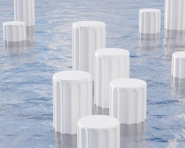 Podi pilastro bianchi per la pubblicità in piedi sul mare con le onde