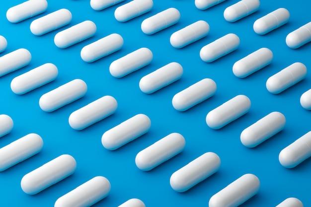 Pillole bianche di molti antidolorifici con un modello su una superficie blu medica. pillole in capsule per alleviare la malattia o la febbre. rendering 3d.