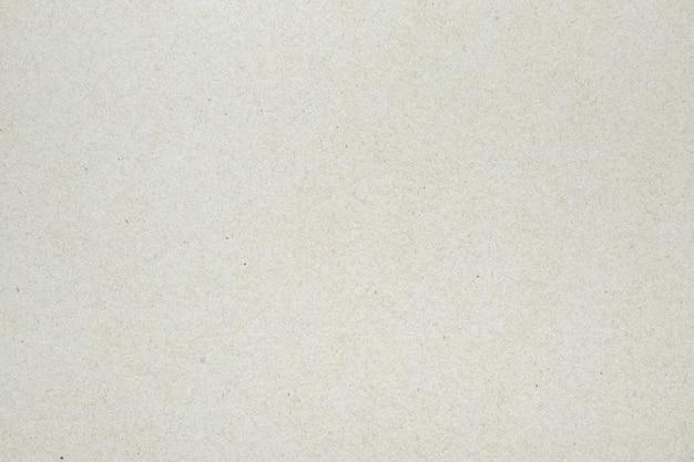Fondo bianco di struttura della superficie del cartone della carta riciclata