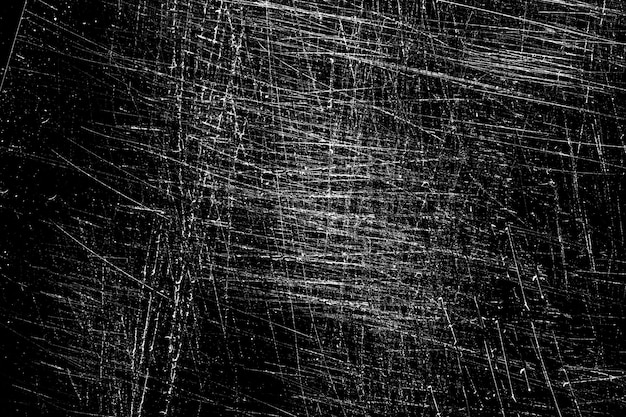 Graffi bianchi su sfondo nero. caotico vetro graffiato. foto di alta qualità