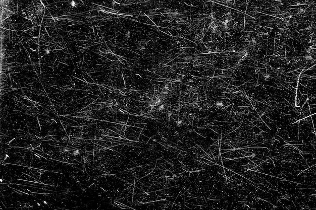 Graffi bianchi su sfondo nero. caotico vetro graffiato.