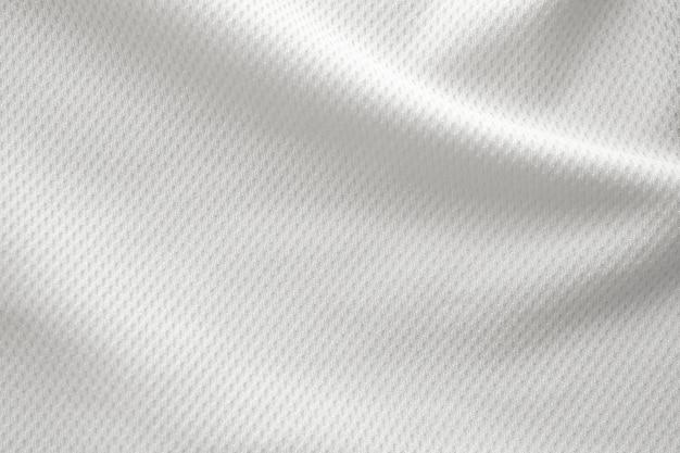 Bianco abbigliamento sportivo tessuto jersey maglia da calcio texture vista dall'alto da vicino
