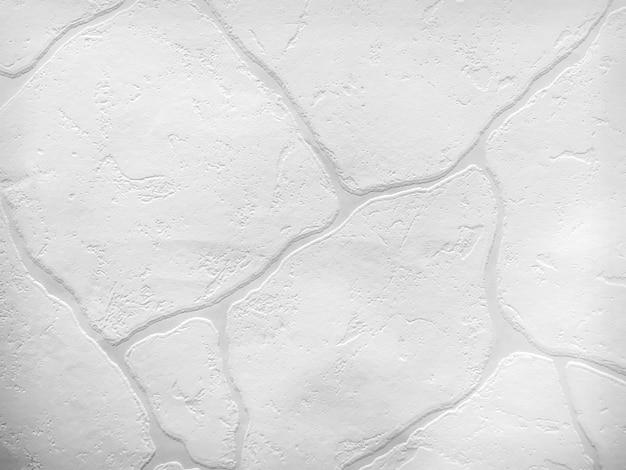 Struttura della superficie del muro di pietra bianca come sfondo.