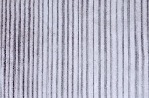 Struttura bianca del cemento del fondo della parete dello stucco con il modello del muro di cemento per fondo