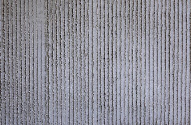 Struttura del cemento del fondo della parete dello stucco bianco con il vecchio modello grigio muro di cemento per lo sfondo