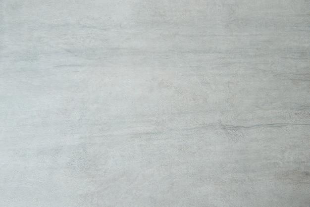 Sfondo muro di stucco bianco. struttura della parete di cemento verniciato bianco