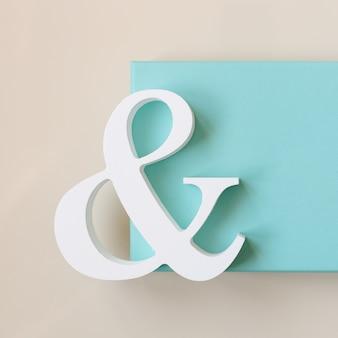 Simbolo bianco e con una confezione regalo di colore turchese sul tavolo