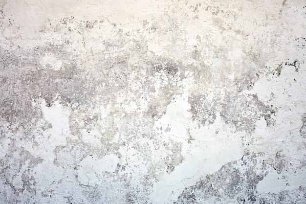 Muro di cemento bianco di struttura. fondo dipinto di dissolvenza con grana grigia del pavimento solido. superficie ruvida e sporca.