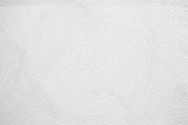 Fondo strutturato dell'estratto bianco della parete con la linea del cerchio.