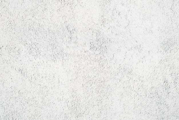 Parete bianca, intonaco decorativo di finitura per esterni, primo piano. sfondo texture in rilievo
