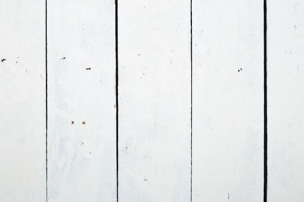 Priorità bassa di struttura del pavimento in legno bianco con sporco e graffiato