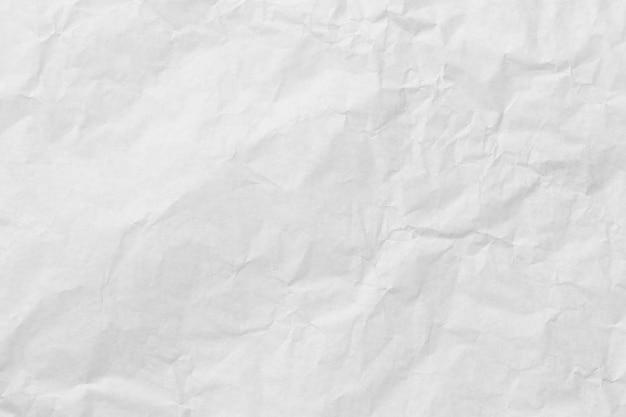 Sfondo bianco carta patinata stropicciata per progettare il tuo concetto di trama.