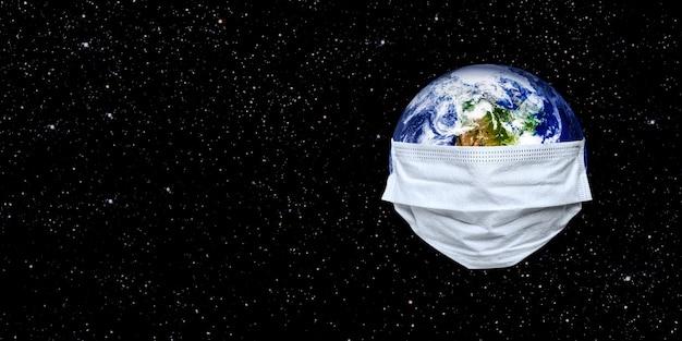 L'intera terra è messa in quarantena, la terra indossa una maschera sul bianco