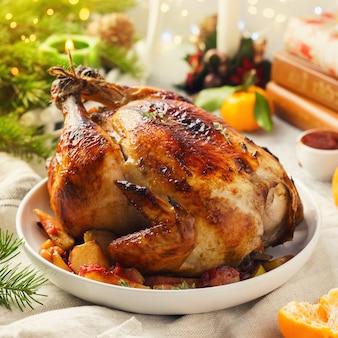 Pollo intero arrosto con mandarini e mele