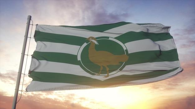Bandiera del wiltshire, inghilterra, che fluttua nel vento, nel cielo e nello sfondo del sole. rendering 3d.