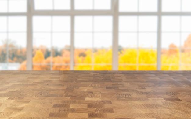 Sfondo del davanzale della finestra con paesaggio autunnale e spazio libero per la tua decorazione, tavolo autunnale lussureggiante e in legno