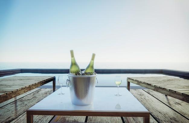 Bicchieri di vino e bottiglie di vino sono posti sul tavolo con posti a sedere. vista mare lato piscina