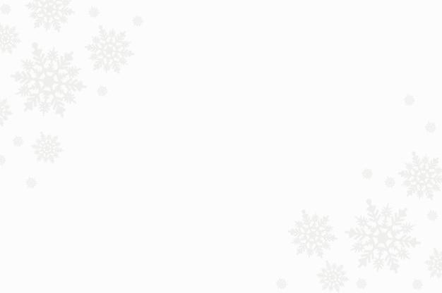 Composizione invernale fatta di fiocchi di neve su sfondo bianco con copia spazio, cartolina di natale, vista piana laico e superiore