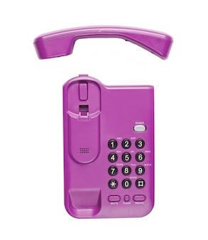 Telefono senza fili dell'ufficio con il microtelefono su un bianco