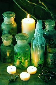 Decorazione di halloween del libro delle pozioni magiche dei vasetti del farmacista della strega