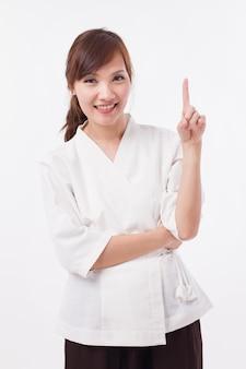 Terapista della stazione termale della donna che indica in su 1 dito, contando, numerando