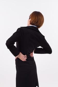 La donna soffre di mal di schiena