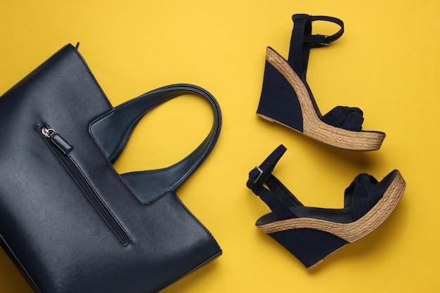Sandali da donna con borsa piattaforma su sfondo giallo scarpe estive da donna e accessori