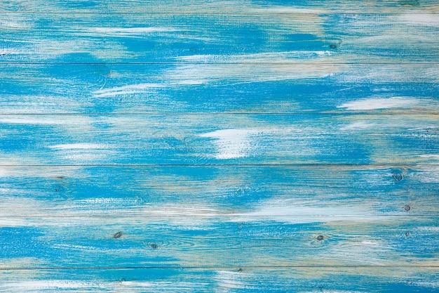 Sfondo di legno con texture blu e bianche