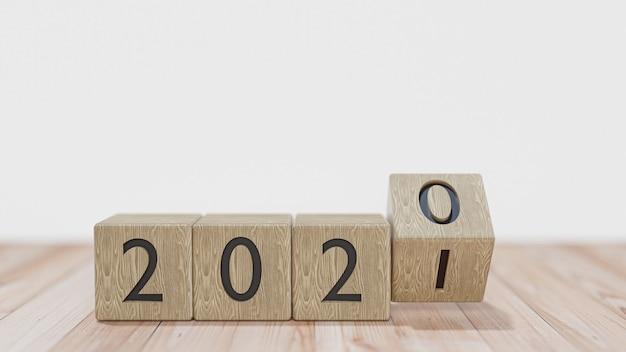Blocchi di legno con il passaggio dall'anno 2020 al 2021 su un muro bianco. rendering 3d.