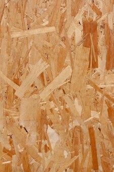 Struttura del truciolare di legno. osb piastra per lo sfondo. struttura di legno del pannello rigido. la struttura del truciolare di legno pressato. verticale.